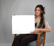Blank board-10. Businesswoman holding a blank board Stock Photography