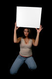 Blank board-2. Woman holding a blank board Royalty Free Stock Photos