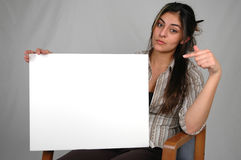 Blank board-9. Businesswoman holding a blank board Royalty Free Stock Photos