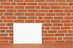 Blank board on a background of a brick wall Stock Image