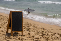 Blank board on beach Stock Images