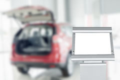 Blank board with blurry car in auto show Royalty Free Stock Photo
