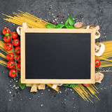 Blank board chalk with ingredients for cooking Italian pasta Stock Photos