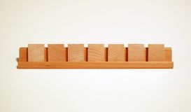 Blank Board Game Tiles. Arranged in a row in a holder royalty free stock photo