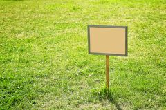 Blank board on green lawn. In park Royalty Free Stock Photography
