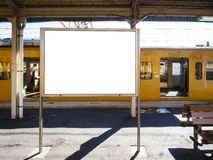 Blank board Template at Train station with Public transportation. Background Royalty Free Stock Photos