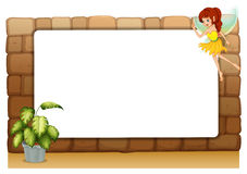 A blank board on a wall with a fairy and a pot of plants Royalty Free Stock Images