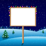 Blank board on winter night with christmas lights Royalty Free Stock Image