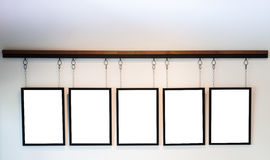 Blank boards hanging on white wall background Royalty Free Stock Photo