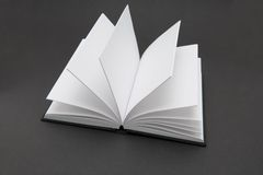 Blank Book. Small black book open with blank pages Royalty Free Stock Photo
