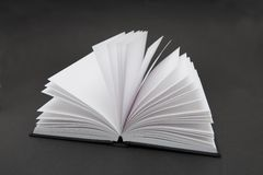 Blank Book. Small black book open with blank pages Stock Photo