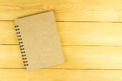 Blank book of brown on wooden table Royalty Free Stock Photography