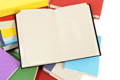 Blank open writing book on untidy pile of books, copy space Stock Images