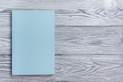 Blank book cover on textured wood background. Copy space Royalty Free Stock Images