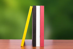 Blank Book Covers. Blank standing book covers on wooden table, back view on green blurry background stock photography