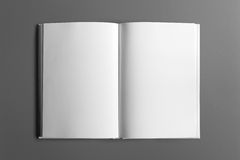 Blank book isolated on grey. To replace your design or message Royalty Free Stock Photo