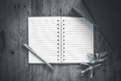 Blank book on old wooden background with black pencil. Royalty Free Stock Photos