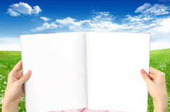 Blank Book Open. Open book with blank pages. Sky and grass background