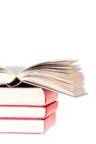 Blank Book open over tree red books Royalty Free Stock Photography
