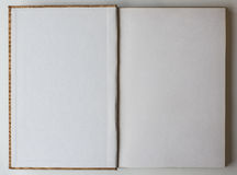 Blank book opened to the first page. Stock Images