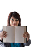 Blank Book Pages. A twenties plus size model holding up a book with blank pages and copyspace royalty free stock photography
