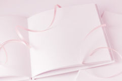 Blank book with pink ribbon. Royalty Free Stock Image
