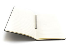 Blank book or planner open with a pen isolated. On white background Royalty Free Stock Photos