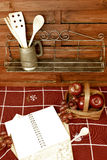 Blank book recipes and fruit basket. Blank book recipes fruit basket and shelves with utensils country  style Royalty Free Stock Image