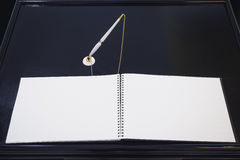 Blank Book signing with pen on table Black background Royalty Free Stock Photo