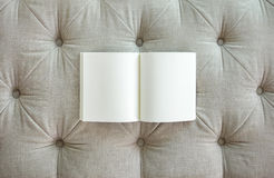 Blank book on sofa. Object and background texture Royalty Free Stock Image