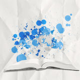 Blank book and splash colors choice as concept Royalty Free Stock Image