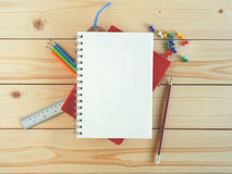 Blank book and stationeries on the wooden desk Royalty Free Stock Photography