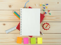 Blank book and stationeries on the wooden table Stock Images