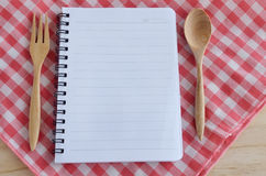Blank book with wooden spoon Stock Image