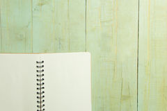 Blank book on wooden table. High angle view Royalty Free Stock Photo