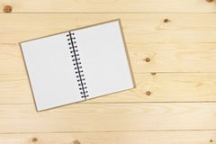Blank book on wooden table, top view angle. Copy space Royalty Free Stock Image