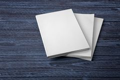 Blank books. On dark wooden background Royalty Free Stock Photos