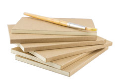 Blank books for writing and drawing with paint brush Stock Image