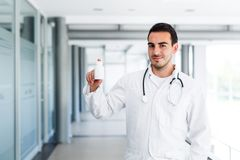 Blank bottle held by doctor stock photo