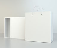 Blank box open and shopping bag on a gray floor. 3d rendering.  Stock Image