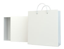 Blank box open and shopping bag on white background. 3d rendering.  Stock Photos