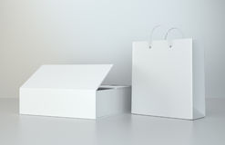 Blank box and shopping bag on a gray floor. 3d rendering.  Royalty Free Stock Photo