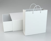Blank box and shopping bag on a gray floor. 3d rendering.  Stock Images