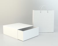 Blank box and shopping bag on a gray floor. 3d rendering.  Royalty Free Stock Photos