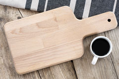 Blank breakfast board and coffee cup on a vintage table Royalty Free Stock Images