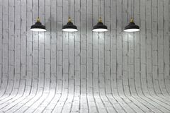 Blank brick wall illuminated by lamps above Royalty Free Stock Photo