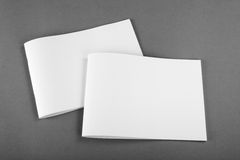 Blank Brochure magazine isolated on grey. To replace your design Royalty Free Stock Photo
