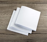 Blank Brochure magazine on wooden background Royalty Free Stock Photography