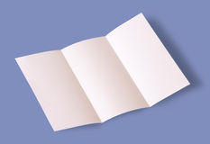 Blank brochure. White blank brochure on blue background Stock Photos