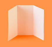 Blank brochure. White blank brochure on orange background Stock Images